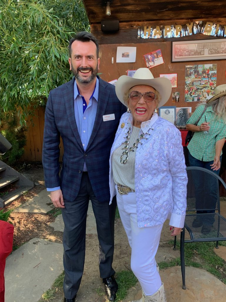 Local celebrity, Cookie Lockhart, with Andres Cladera, artistic director of Opera Steamboat, at Cookie's birthday celebration on June 29th.