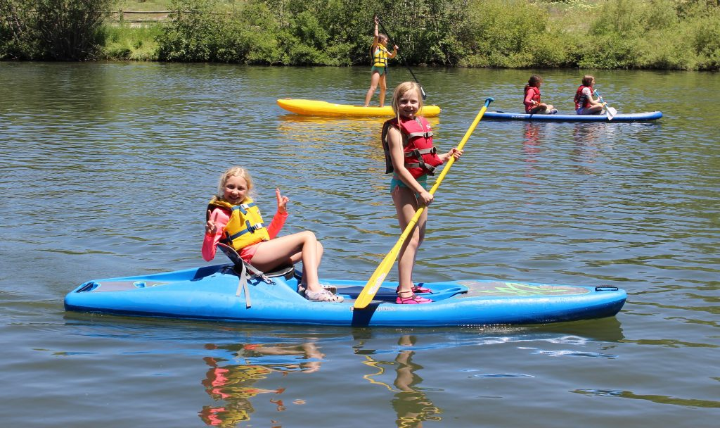 KAC Pioneers paddle paddle boards at Fetcher Pond.