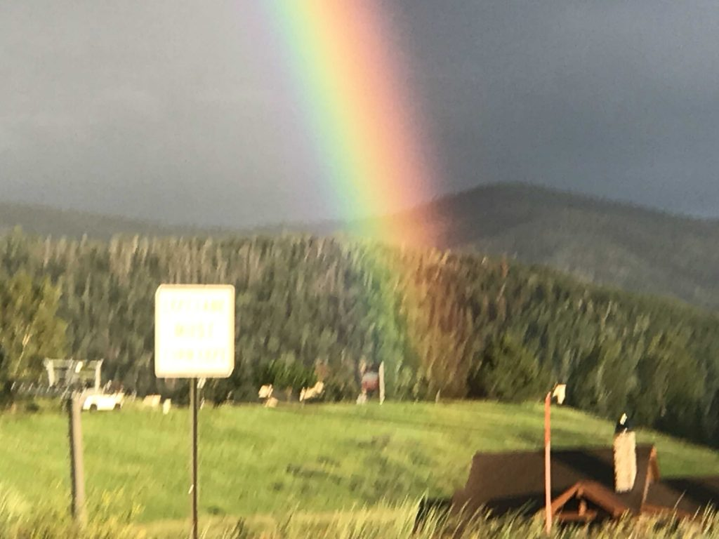 A rainbow appears after a short rain storm on Monday, July 22.