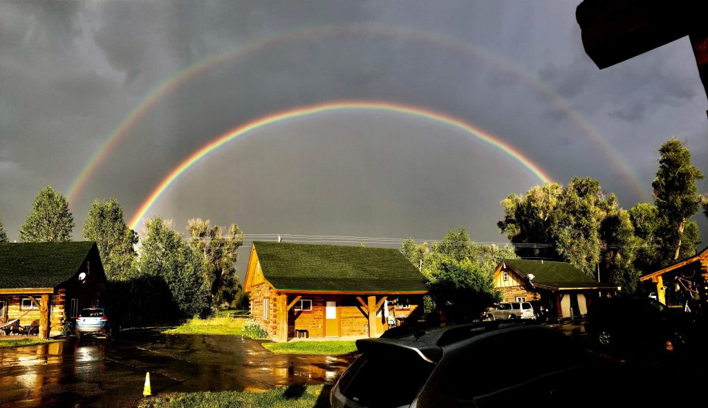 Double rainbow Saturday July 27th over the River bend cabins and golf course looking east.