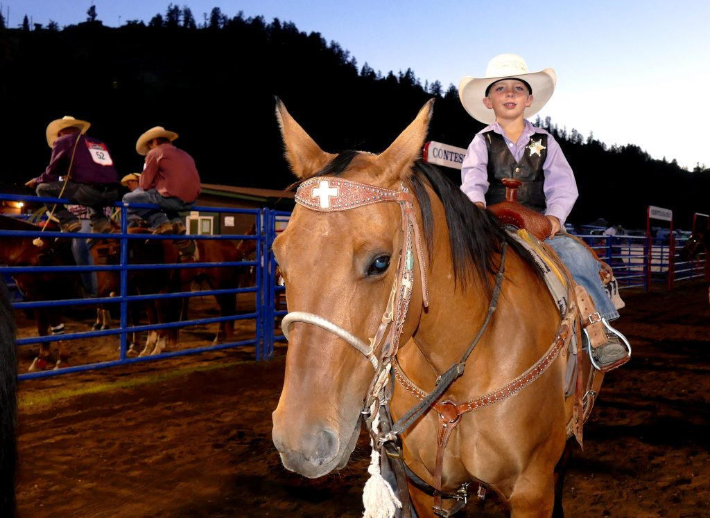 Cute little cowboy. This little guy is from Maybell, and he won the Ram Scramble Friday night! These little guys were in the peewee barrel racing.