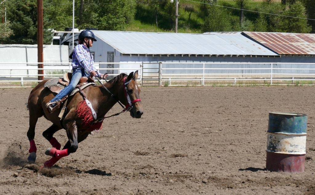 Barrel racing at Gymkhana (jim-kon-nuh) at the Routt County Fair in Hayden