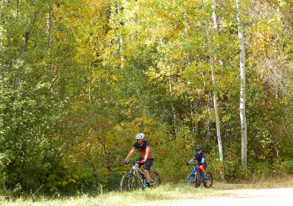 A dad and son on a bike ride along the trail.
