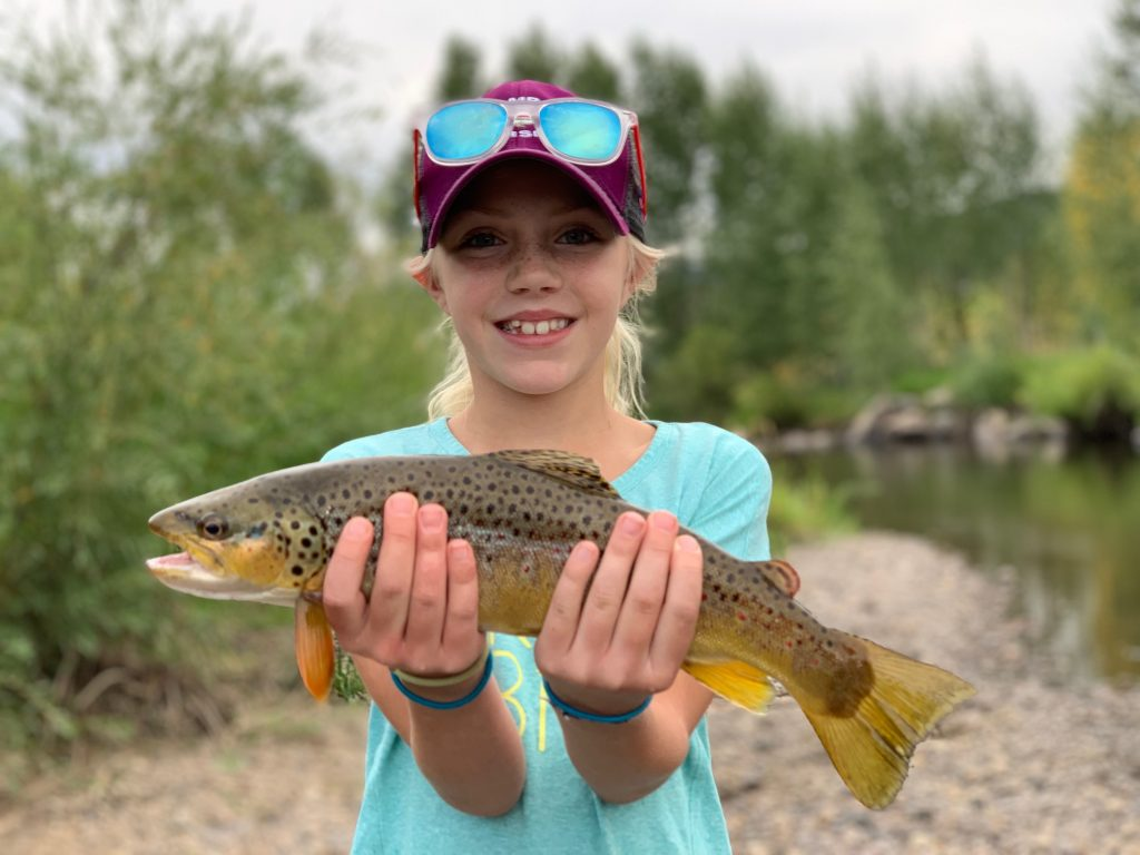 Mike Montgomery's daughter holds a fish she caught.