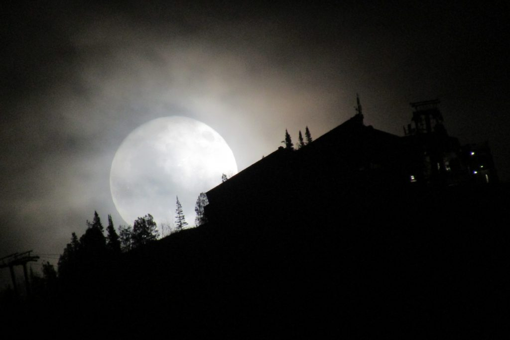 The moon rises over Steamboat Resort.