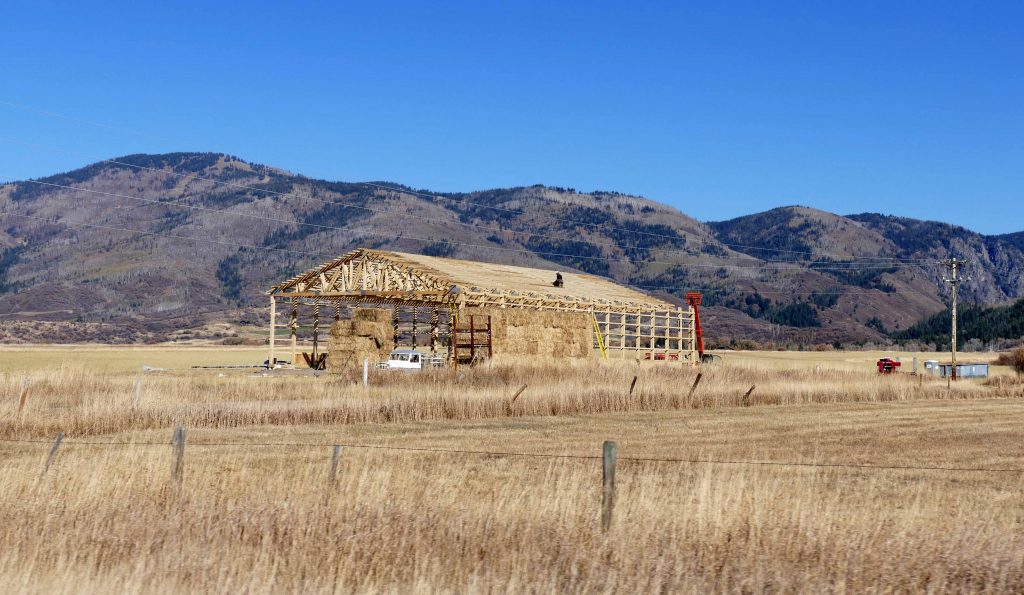 A barn is under construction along Routt County Road 131.