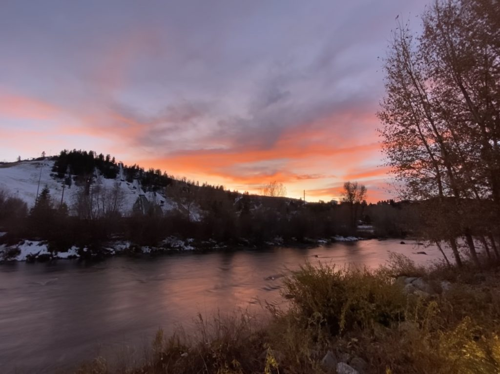 The sun sets over the Yampa River.
