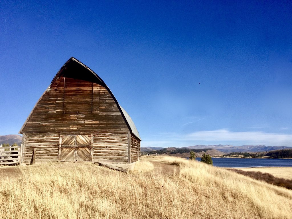 Blue skies and Steamboat Lake provide a backdrop for the Fetcher Brothers Barn.