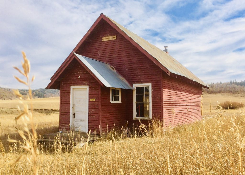Golden grass highlight the old Cow Creek Schoolhouse on Routt County Road 43.