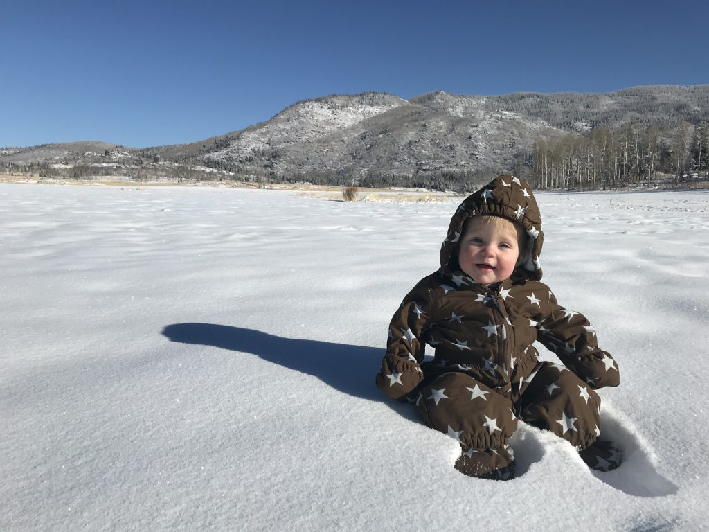 Hazel Harden enjoys a day in the snow on a blue bird day.