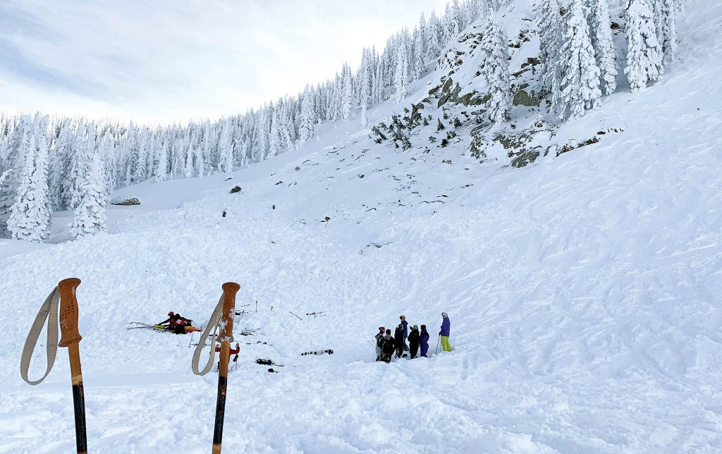 People gather at the scene of an avalanche on Steamboat Resort on Sunday, where one man was rescued after being buried. The rescue was the result of a joint effort between ski patrol and three bystanders.