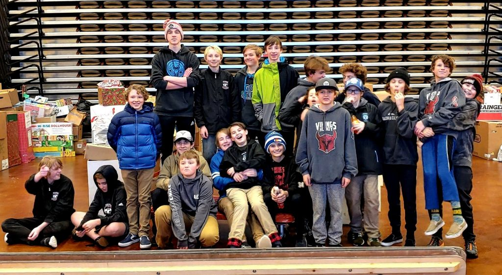 Bantam team with Steamboat Stampede Youth Hockey Association helped out with the Holiday Market for Routt County United Way.