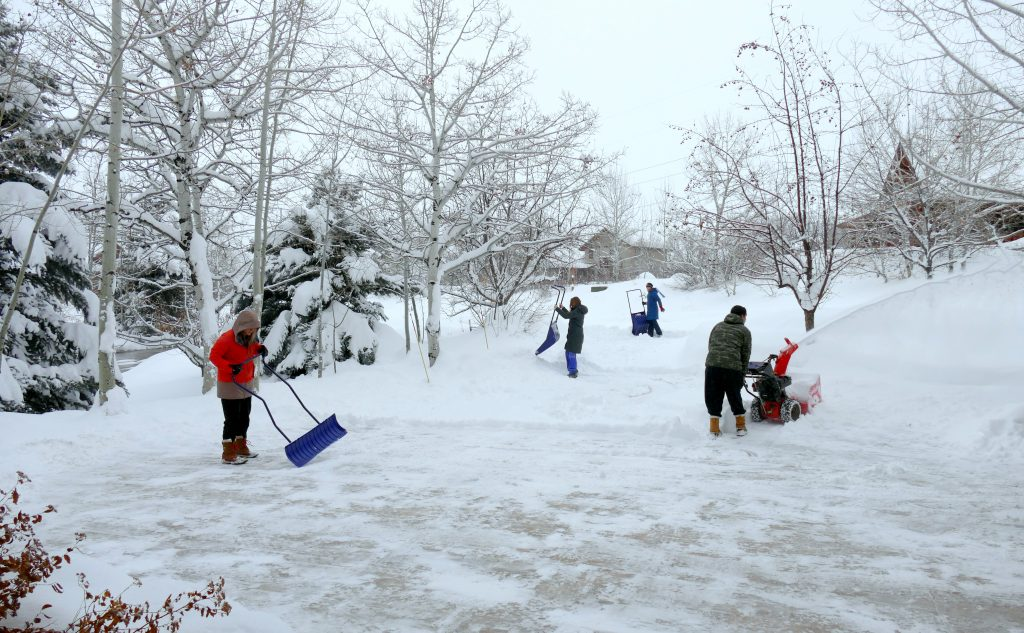 The kids and houseguests are out shoveling the driveway on a very powdery snow day in Steamboat Springs.