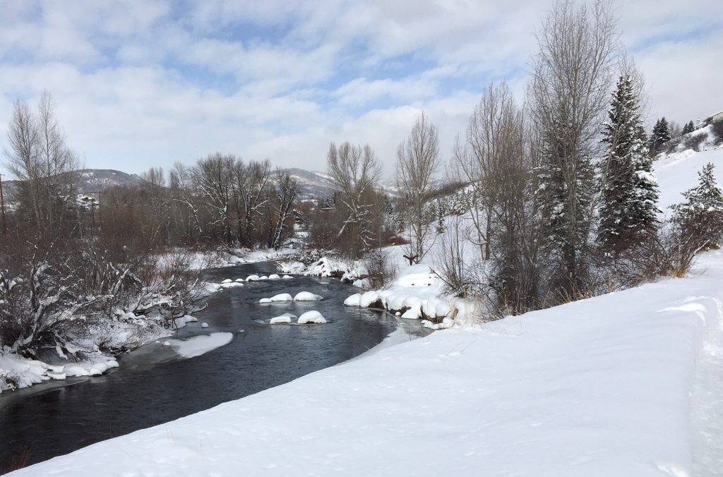 The Yampa River continues to run even under snow.