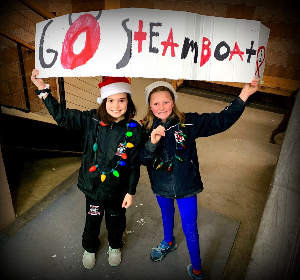 These Steamboat Stampede sisters were cheering on their brothers in Sunday's PeeWeeA game against Summit, at Howelsen Ice Arena.