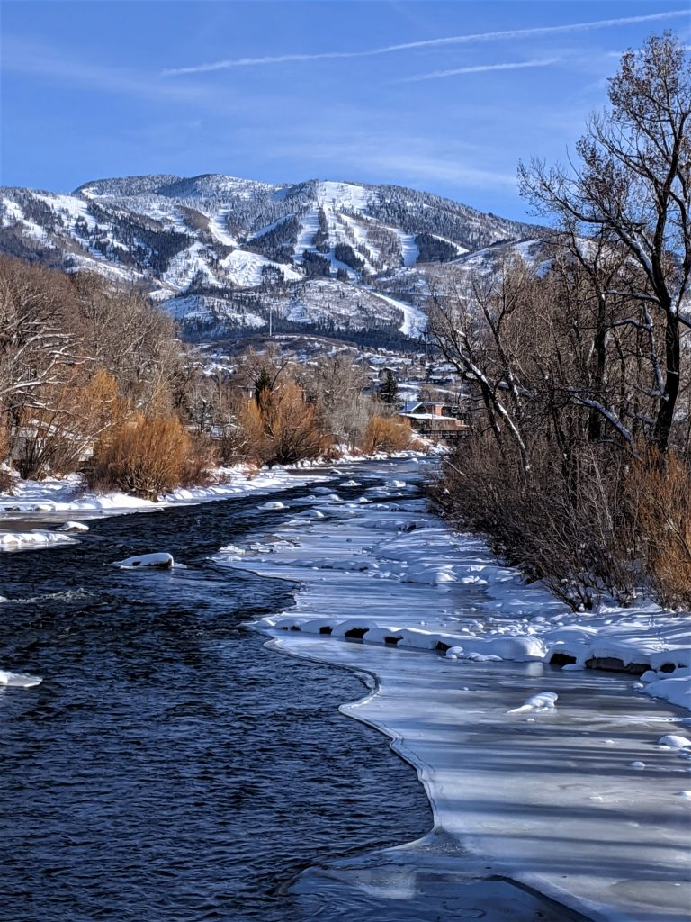Snow and ice coat the Yampa River.