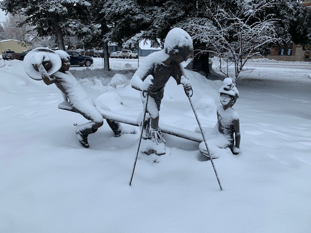 The kids sculpture in front of the historic Routt County Courthouse is covered in a layer of snow.
