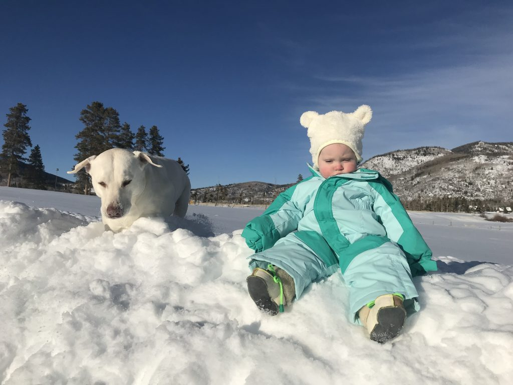 Hazel, right, and her dog enjoy the snow in Yampa.