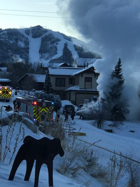 Steamboat Springs Fire Rescue firefighters put out a car fire along Blue Sage Road in Steamboat Springs.