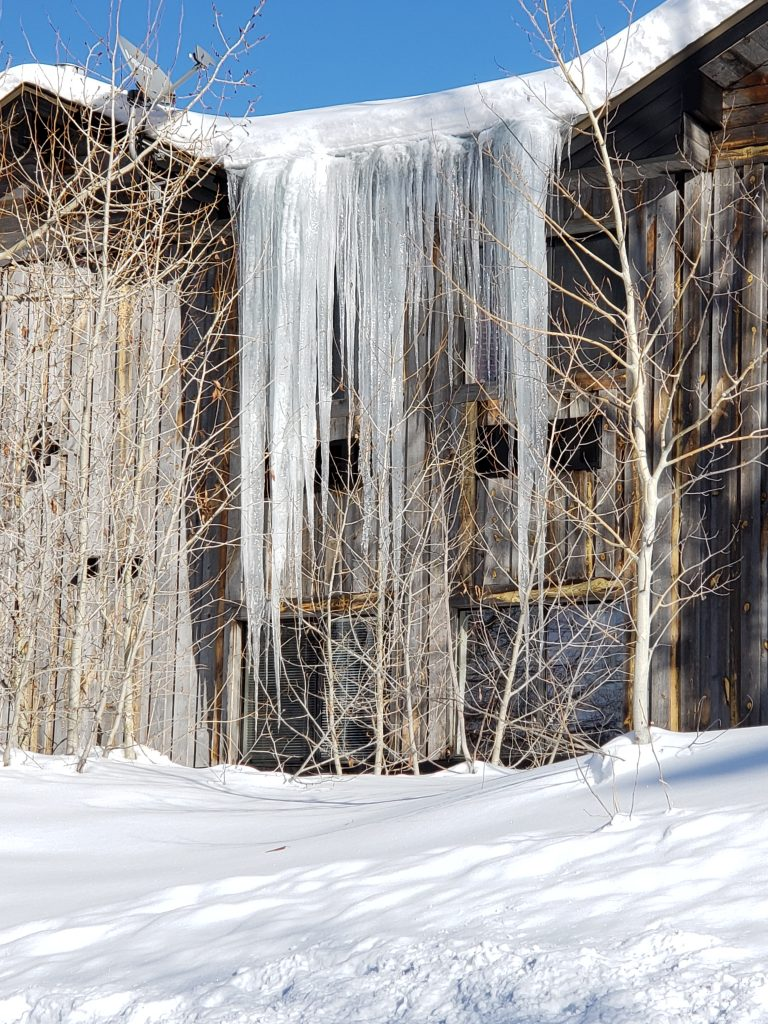 Long icicles grow on a condominium complex.