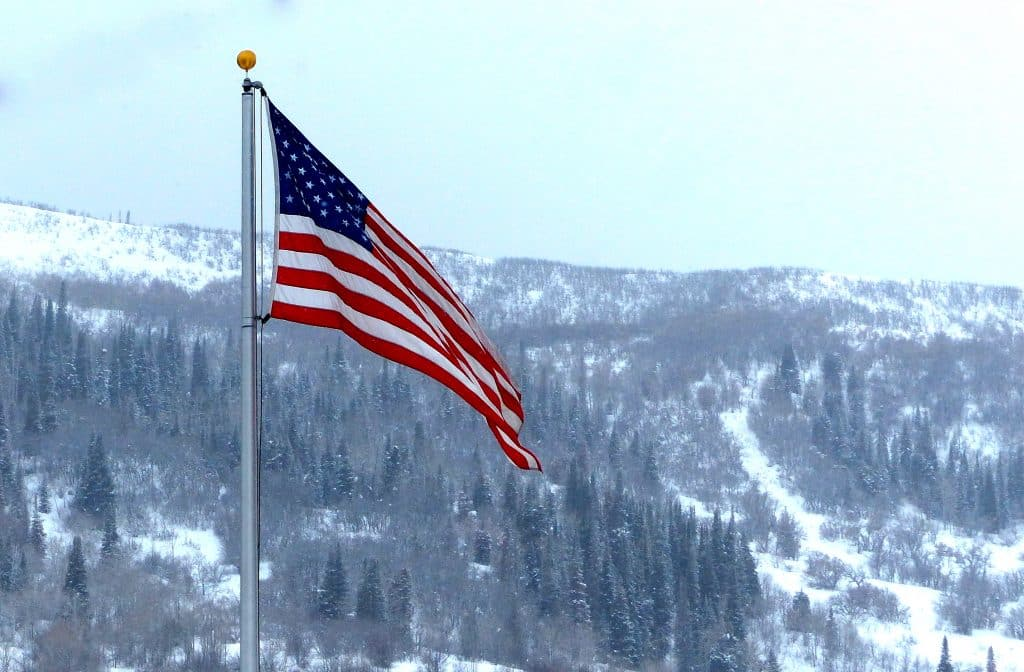 Snow blows in around an American Flag in Steamboat Springs.