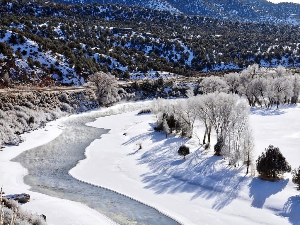 The Colorado River, as seen from Colorado Highway 131 near Bond, is covered in frost.