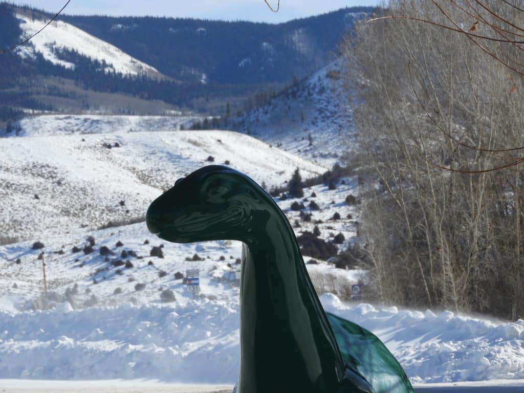 The Sinclair dinosaur in Yampa stands out against the snow.