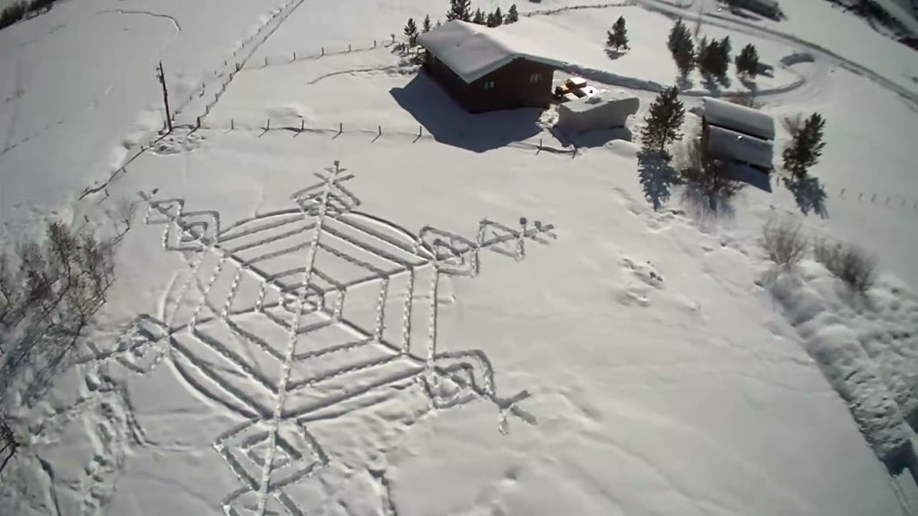 A snowflake is drawn in snow north of Steamboat Springs.