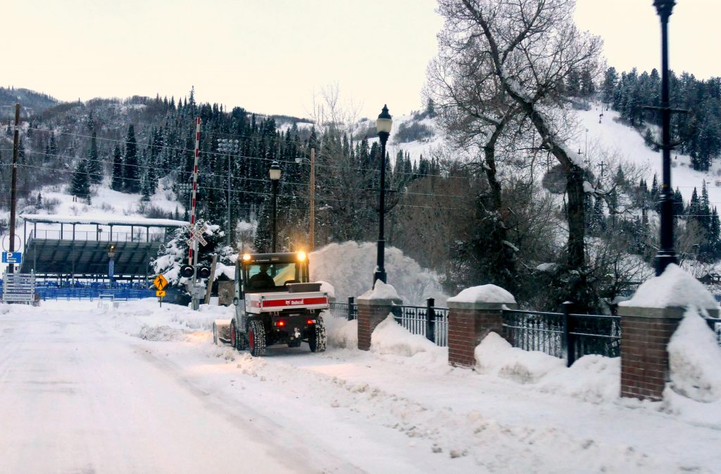 Snowplows and bobcats in Steamboat Springs were hard at work this morning with the new snow overnight. The 5th Street Bridge sidewalk was plowed with Romick Rodeo Arena and slopes of Howelsen Hill in the background.