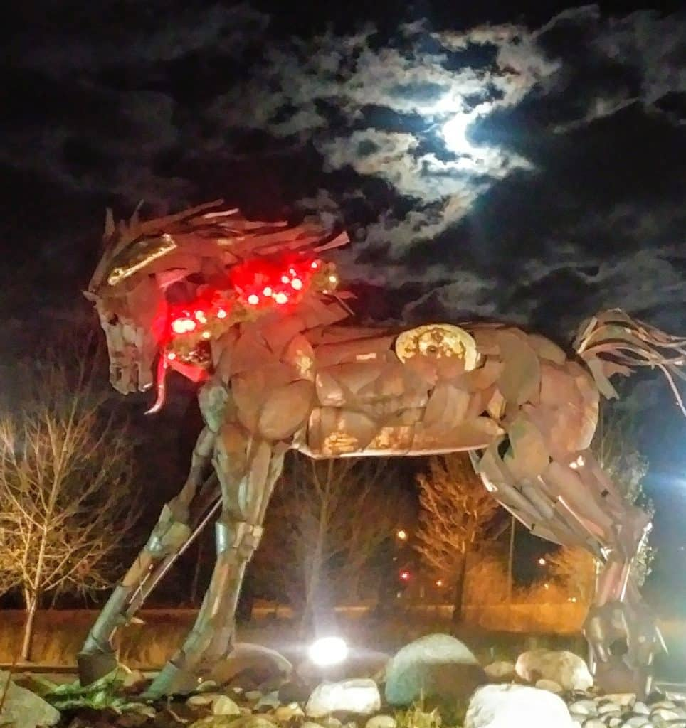 The horse at Wildhorse Plaza lights up the sky.