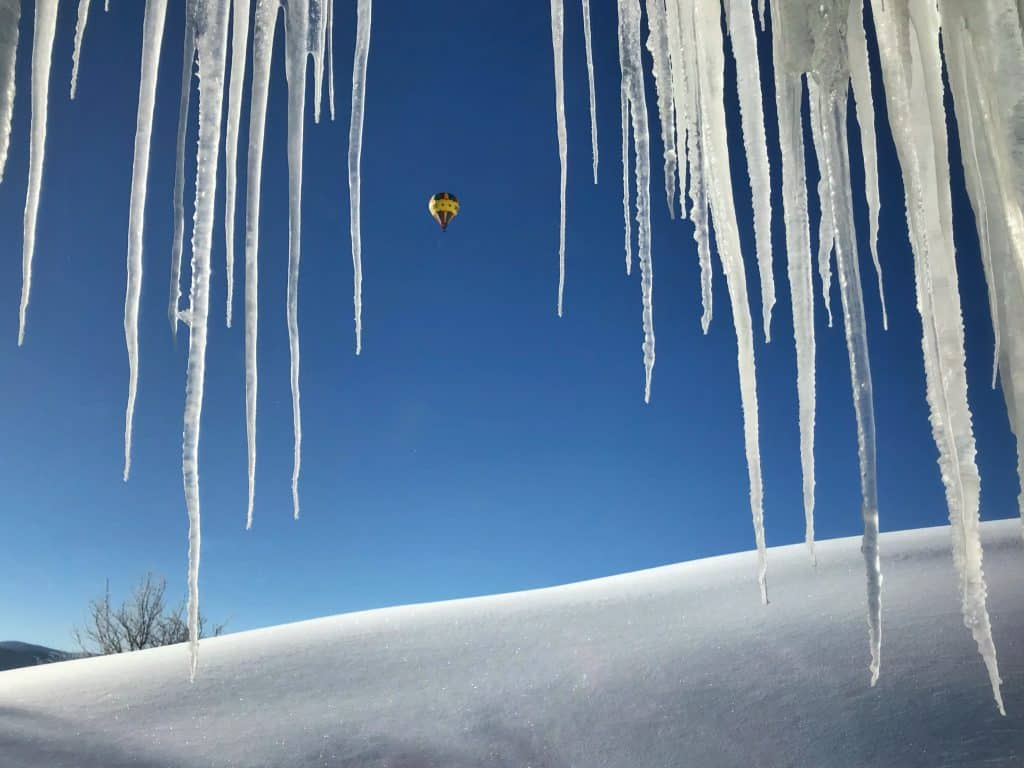 Balloon rising into icicles