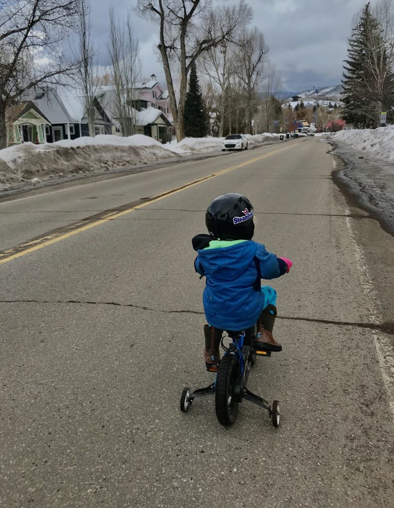 A child goes on bike ride before the snow storm hit Monday, Feb. 3.