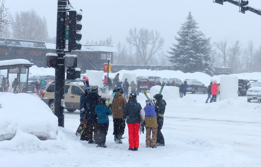 Skiers wait at a bus stop for a Steamboat Springs Transit bus to take them to Steamboat Resort on Thursday, Feb. 6.