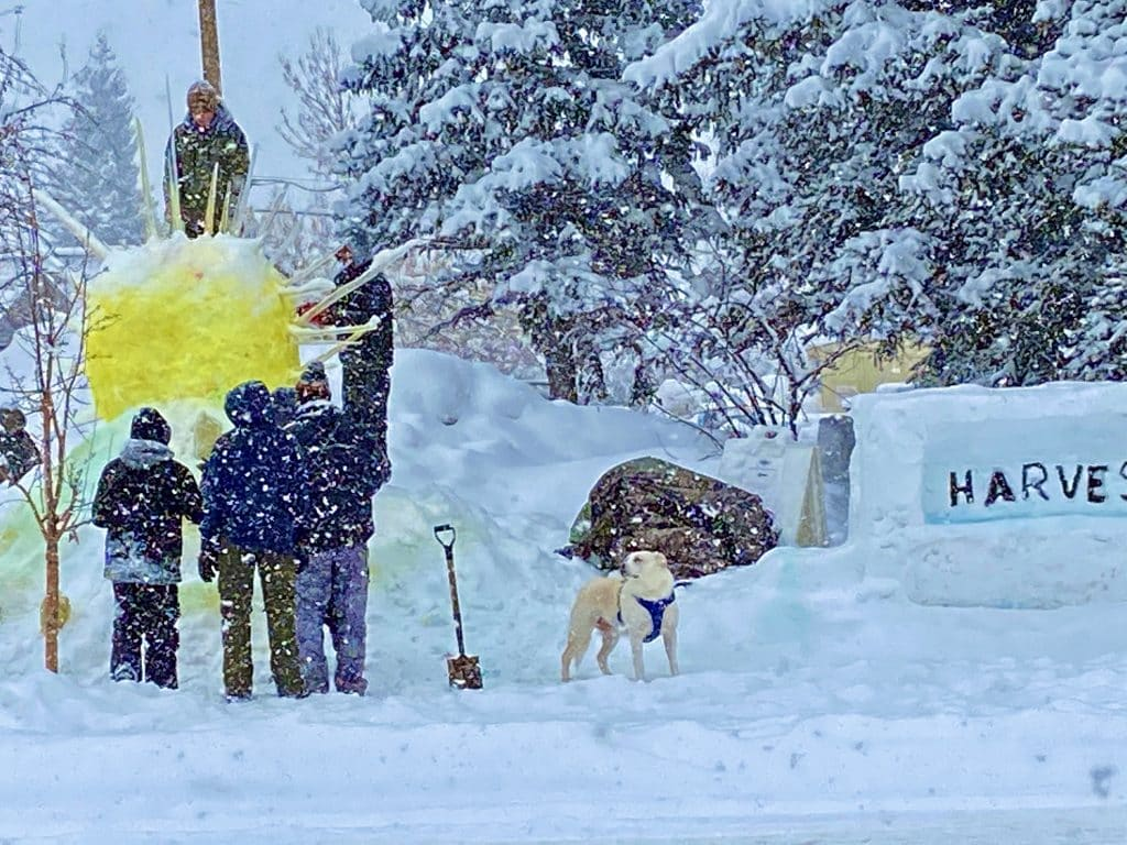 A group works on a snow sculpture for Winter Carnival on Thursday, Feb. 6.
