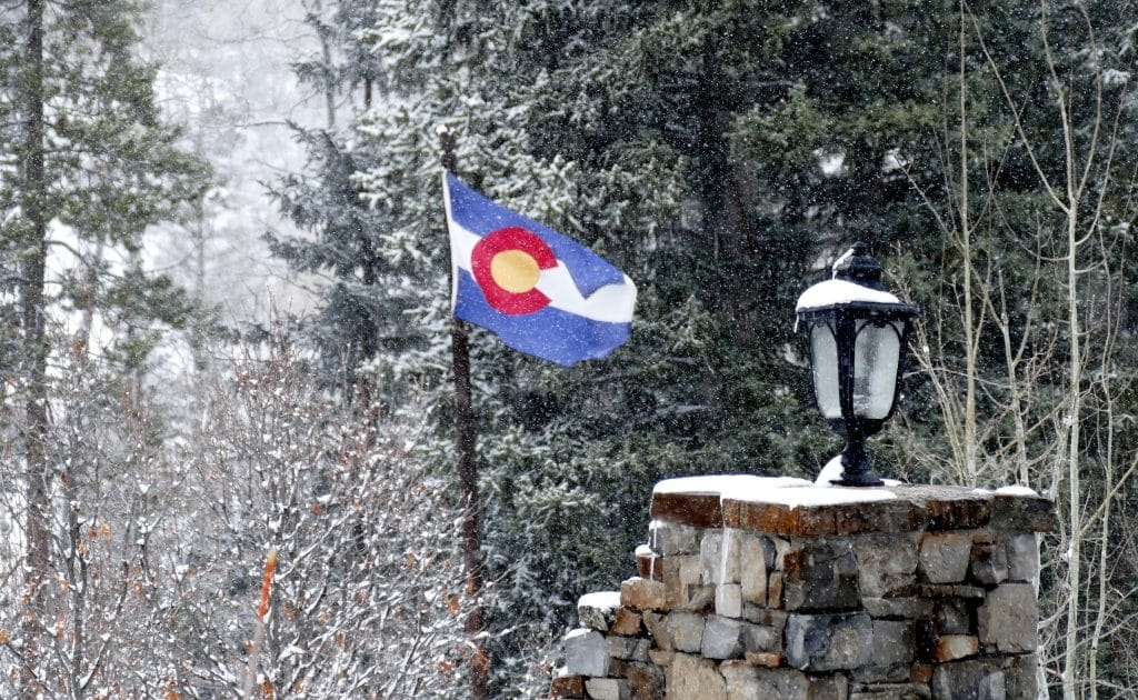 A snowy picture of the Colorado flag. It has been snowing all day in Steamboat Springs today.