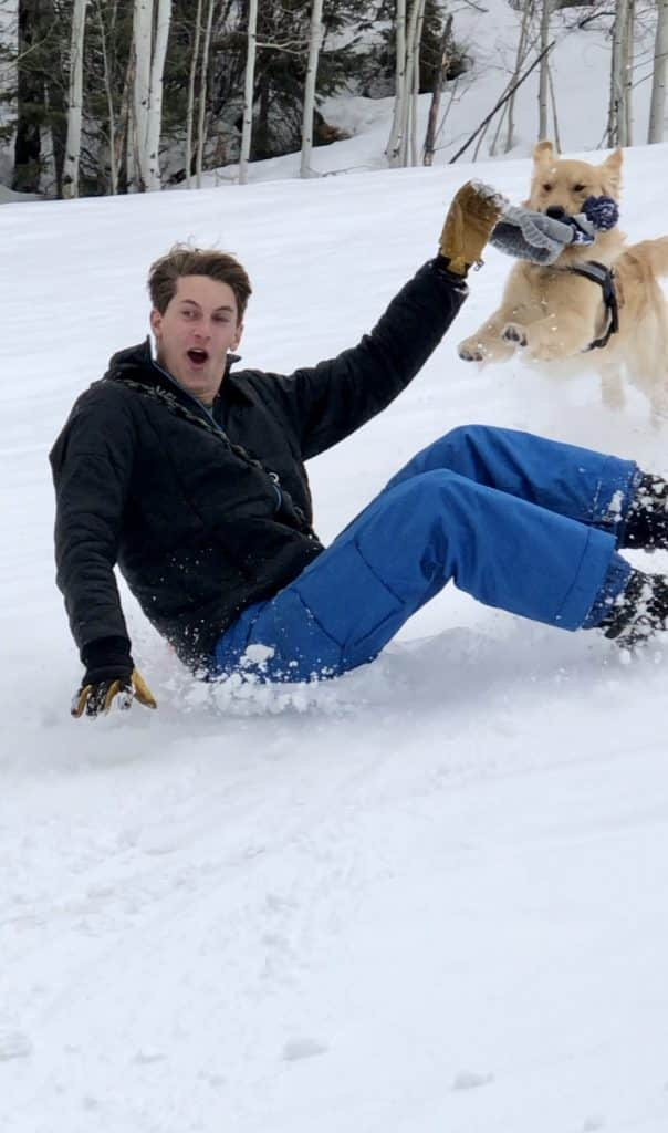 Brooks Birkinbine and his dog, Finley, having fun sliding down a hill. Brooks is a Steamboat Springs High School graduate, now home from Grand Canyon University in Phoenix, Arizona.