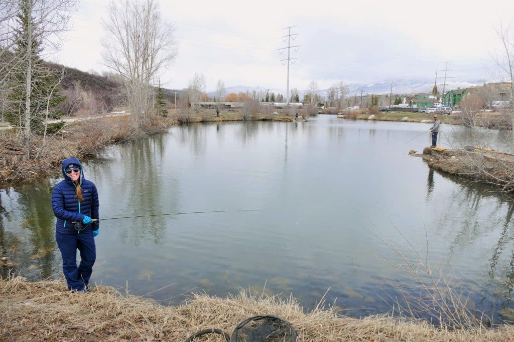 a picture of four of our family members social distancing fishing at Fetcher's Pond in Steamboat.