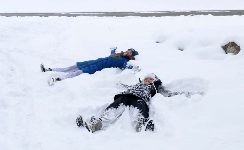 Meghan and Libby Lukens made snow angels in our driveway today. Then they threw snowballs at their dad's window in his home office.