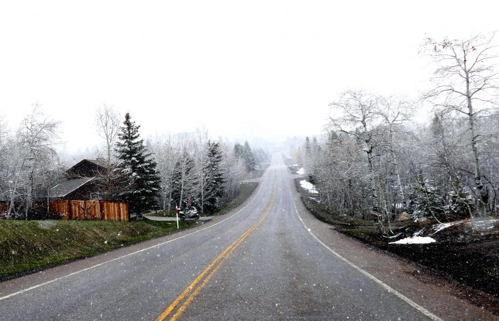 a snowy shot of Fish Creek Falls Road with not a car in sight.