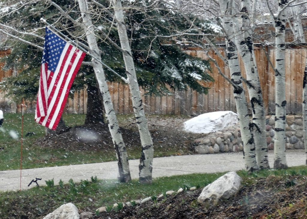 a snowy flag at a house in Steamboat Springs