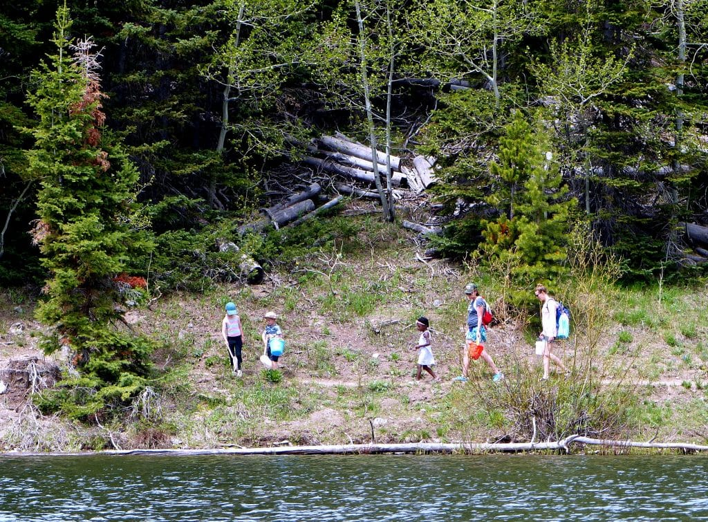 Pearl Lake Hiking is some moms and kids hiking along the trail around Pearl Lake with their fishing nets.