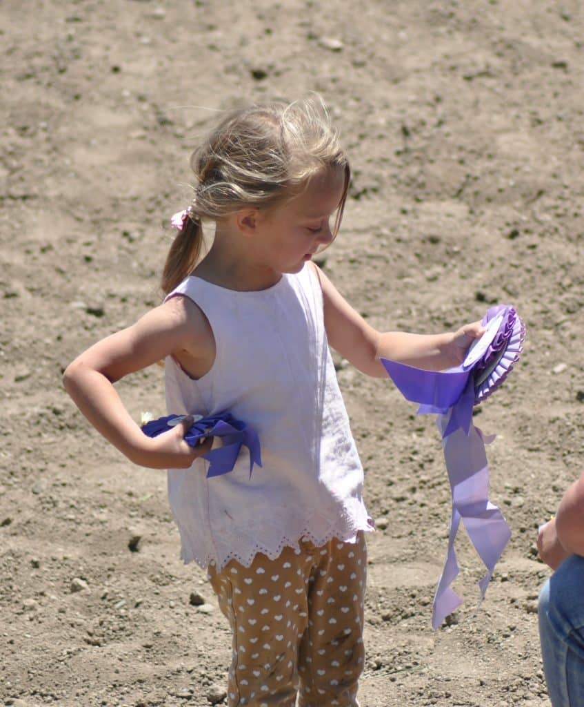 Violette Sorka Ella picks up one of her many first place ribbons at the Hayden Horsepower Gymkhana at the Routt County Fairgrounds on June 20, 2020