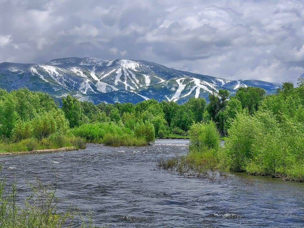 Yampa River and Steamboat Resort after a June snow.