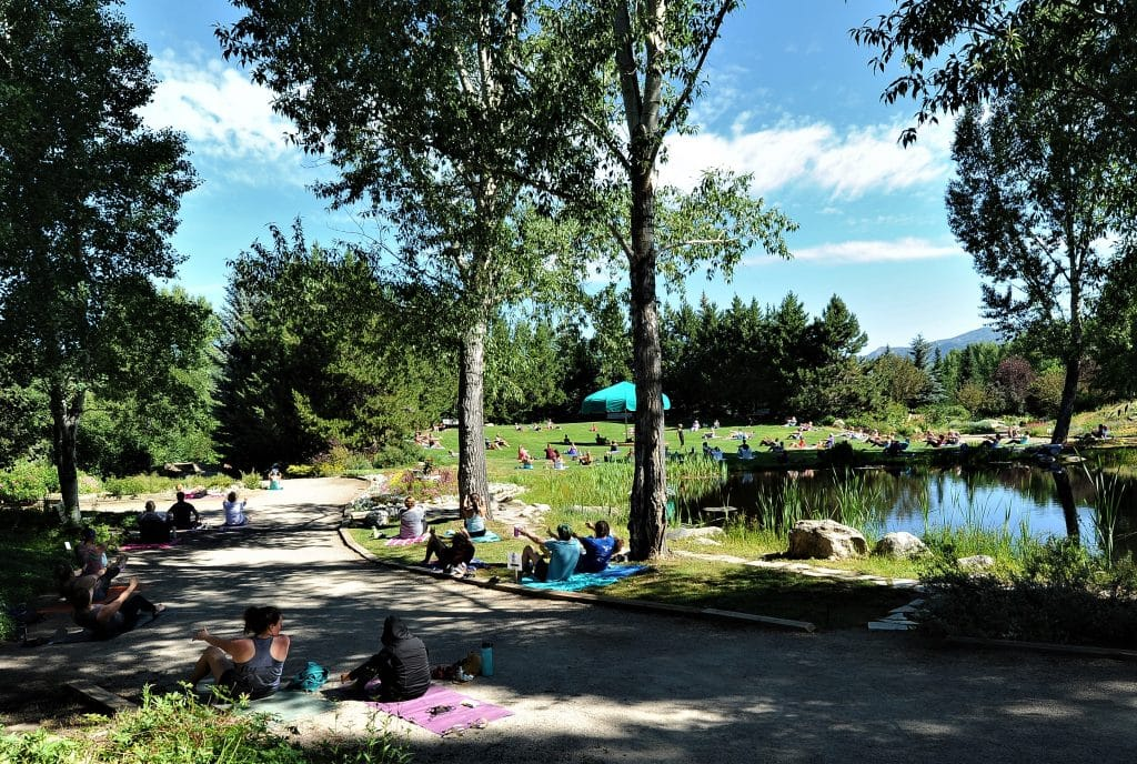 In the Yampa River Botanic Park on Saturday, social distancing at Yoga on the Green required overflow people to lay their mats outside the grass of the Green, even on the gravel road.