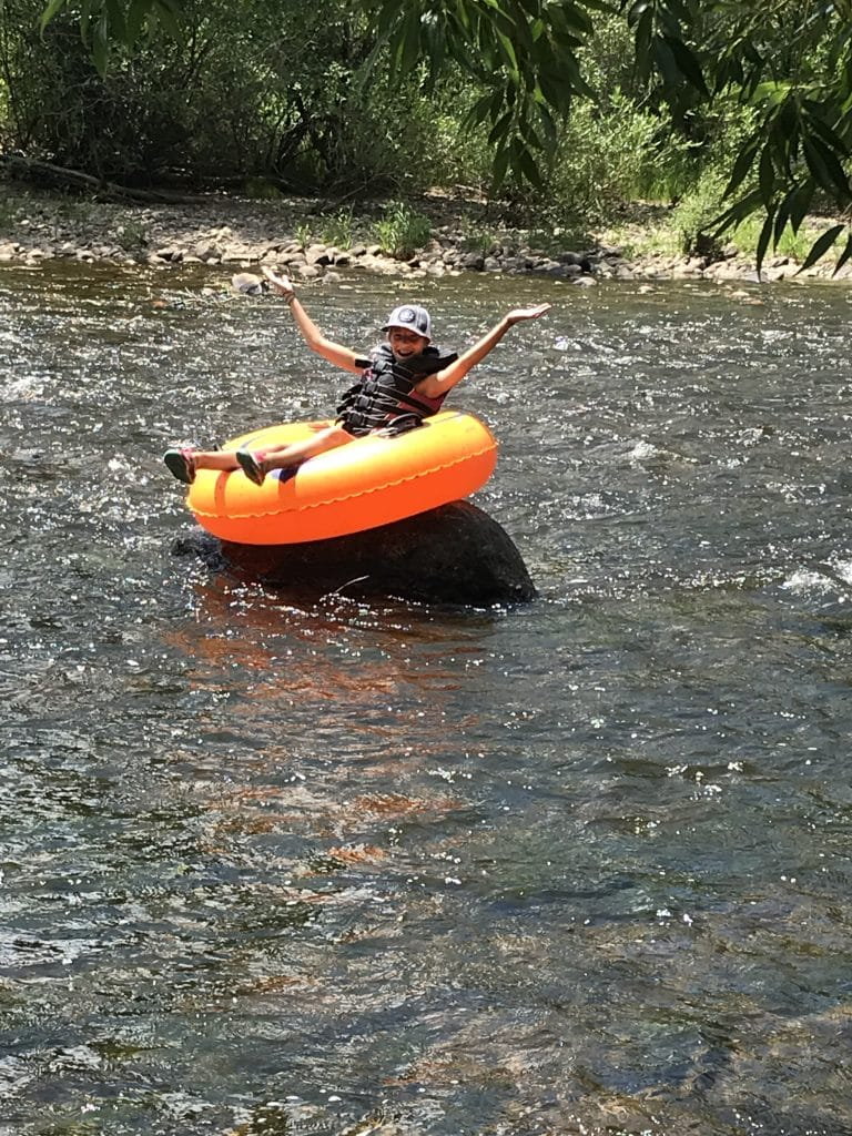 Coral Whitaker gets high and dry on Friday while tubing the Yampa. Yampa river water level dropping fast!