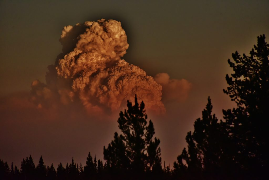 Wildfire plume illuminated by the sunset as seen from Dumont Lake on Aug. 15.
