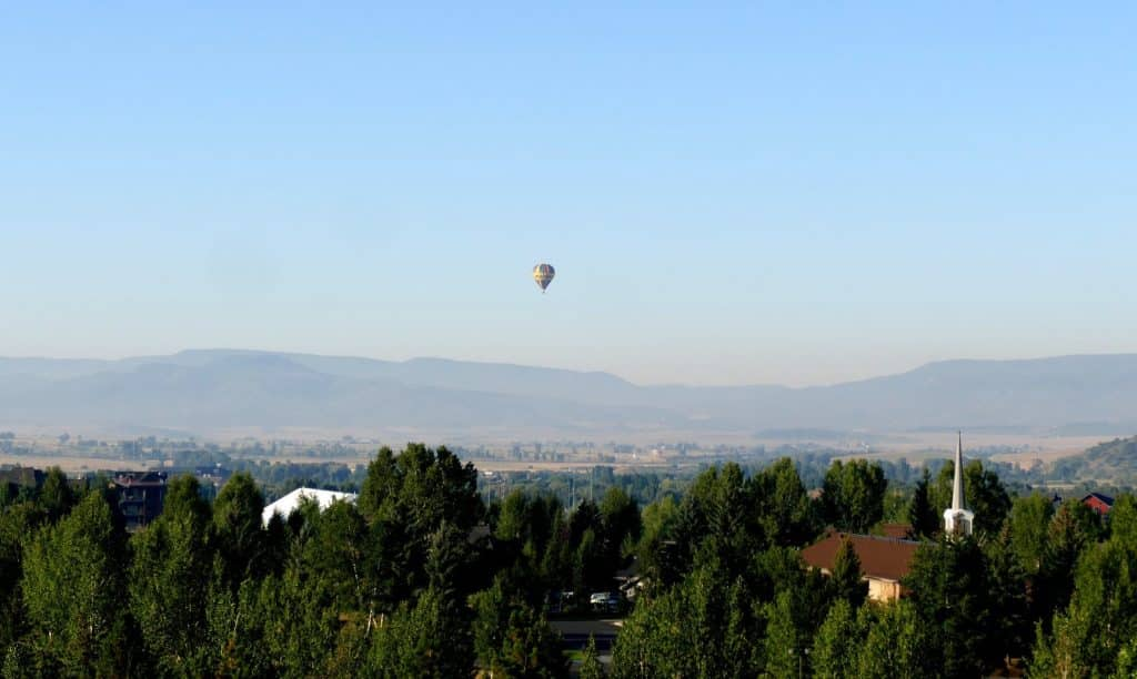 Here is a hot air balloon over Steamboat Springs and you can see the smoke and haze in the background, from the fires in neighboring counties around Routt County.