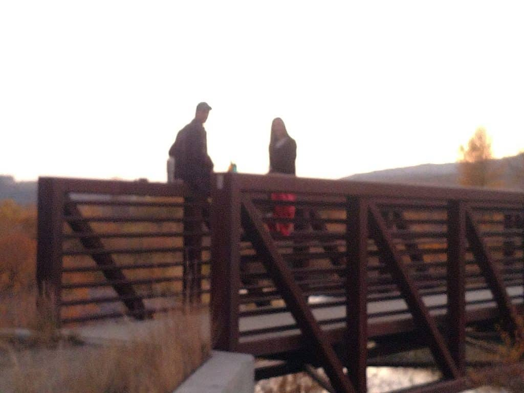 I photographed these two enjoying a bottle of wine and the evening sunset while sitting on the bridge in Chuck Lewis.