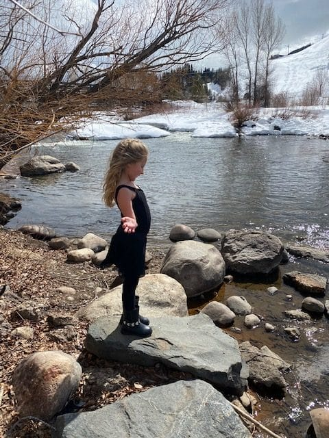 Ayla Schneider, age 5, from Steamboat Springs is enjoying some springtime sunshine after dance class.