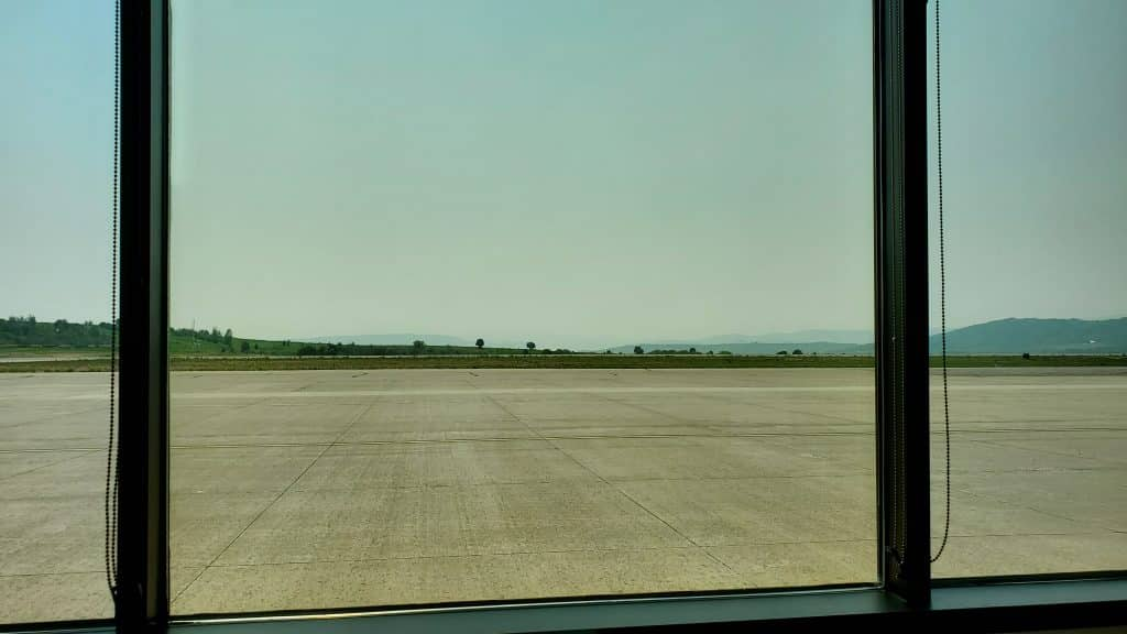 Smokey skies and helicopters are back.  Bob Adams airport today.